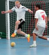 <h5>Player leaping over the ball in front of the goal</h5>