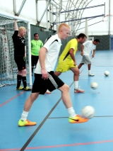 <h5>Footwork training photo of three players in a line going into the distance </h5>