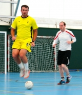 <h5>Gareth Jones Sports Football lead jumping over ball in training</h5>