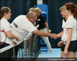 <h5>Tennis players shake hands over the net after a match</h5>