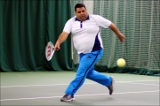 <h5> Tennis player running across the court to reach the ball</h5>