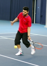 <h5>Tennis player about to hit the ball</h5>