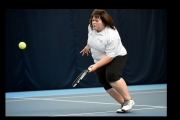 <h5>Tennis player running to get the ball</h5>