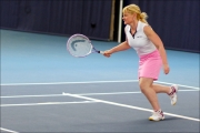 <h5> Tennis player running to get the ball</h5>