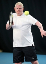 <h5>Close up of a Tennis player Just about to return the ball at head height</h5>