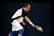 <h5> Tennis player about to return a knee height ball</h5>