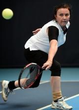 <h5>Close up Tennis player returning a high ball</h5>