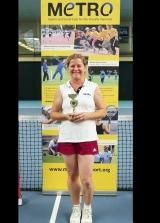 <h5>Tennis player receiving their award</h5>