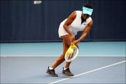 <h5>Tennis player running sideways across the court to return the ball</h5>