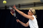 <h5>Close up of Tennis playeras she throws the ball up to serve</h5>