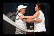 <h5>Womens singles players embrace happly over the net at the end of the game</h5>