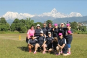 <h5>Womens Blind Cricket Team in Nepal - with a mountain range in the background</h5>