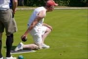 <h5>Bowler on one knee about to bowl </h5>