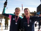 <h5>Guide and skier cheering and wearing their medals</h5>