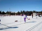 <h5>Skiers in the track following each other </h5>