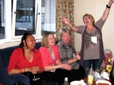 <h5> Skiers singing for the camera back at the chalet </h5>