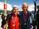 <h5>Smiling guide and skier with their medals</h5>