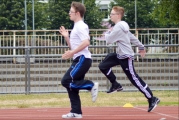 <h5>Two Runner  runing fast at a track event side on view</h5>