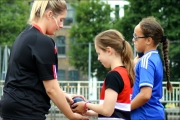 <h5>Guide helping Under 18s  to hold and use the Shot Put</h5>