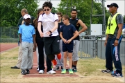 <h5>Long jumper with other under 18s and Guide watching from behind</h5>