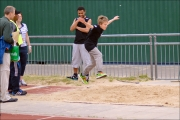 <h5>Under 18  does a Long  Jump flying side ways on to camera at the festival</h5>