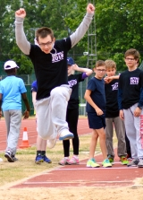 <h5>Close up of long jumper arms held high in the air</h5>