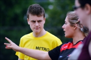 <h5>Volunteer explains the start of the event to a Athlete</h5>
