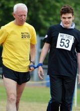 <h5>Guide runner and runner walking the track</h5>
