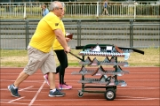 <h5>Motivaste East Volunteers pushing a trolley with starter blocks along the track</h5>