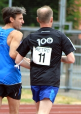 <h5>Guide runner and runner, running along the track away from the camera</h5>