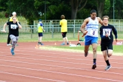 <h5>Relay race two runners very  close to each other</h5>