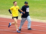 <h5>CLose up of Guide runner and runner in track event</h5>
