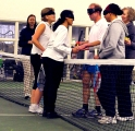 <h5>players shake hand over the net</h5>