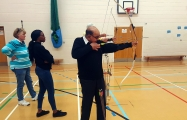 <h5>Archers  side view while lining up shot</h5><p>Archers  side view while lining up shot</p>