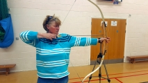 <h5>archer pulls back the arrow and lines up her sight side on view</h5><p>archer pulls back the arrow and lines up her sight side on view</p>