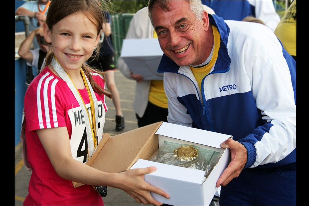 Award Ceremony Happy Girl holding her medals 2014