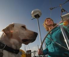 photo of Vicki Sheen and her dog sailing