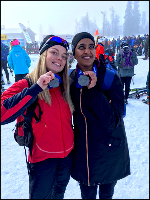 Masuma and guide with Medals
