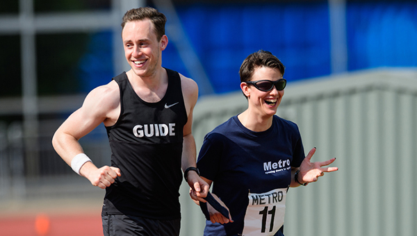 Guide and runner laughing