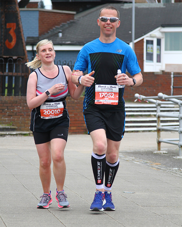 Kelly and guide Mike running Half Marathon