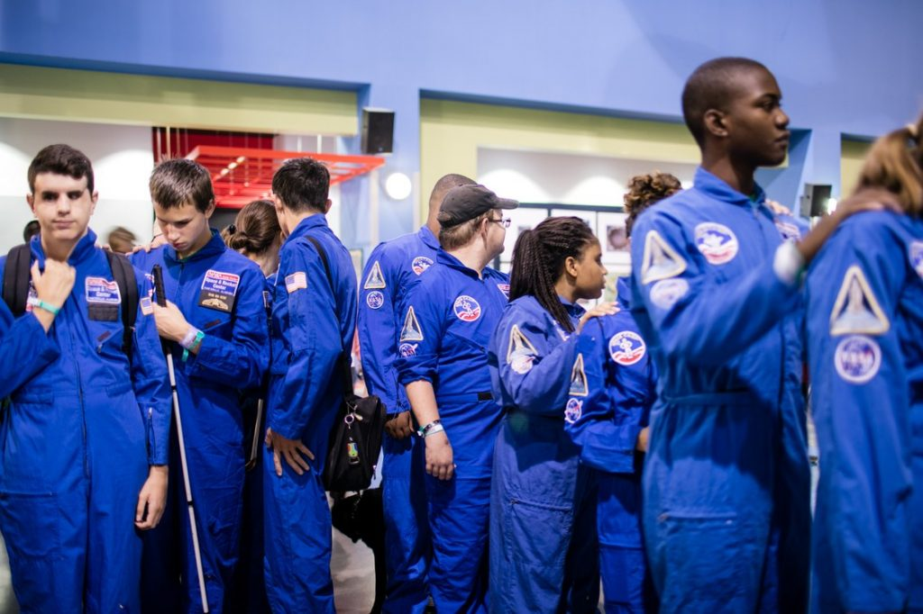 Space campers in their blue flight suits
