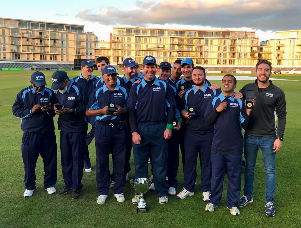 Metro Cricket Team Smiling with thier medal and the cup