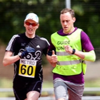 Ben Roback guide running at the Athletics Open