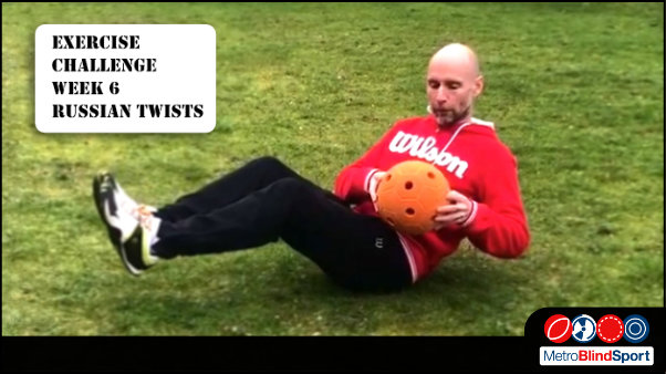 Photo of Mark on the grass holding a large orangesound ball, sitting on his bottom with his legs off the ground, text says New Exercise challenge week 6 Russian Twists: How many Russian Twists in 30 seconds can you do!