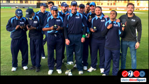 Group photo of the Metro Cricket team smiling with their 2019 BBS cup trophy and medals