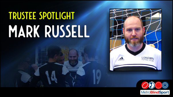 Photo of Mark Russell on a blue spotlight background with a faded photo on of mark in the middle of a foorball team huddle / meeting on the pitch laughing with the players text says Trustee Spotlight Mark Russell