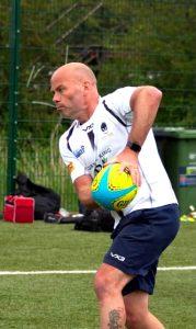 Matt passing rugby ball