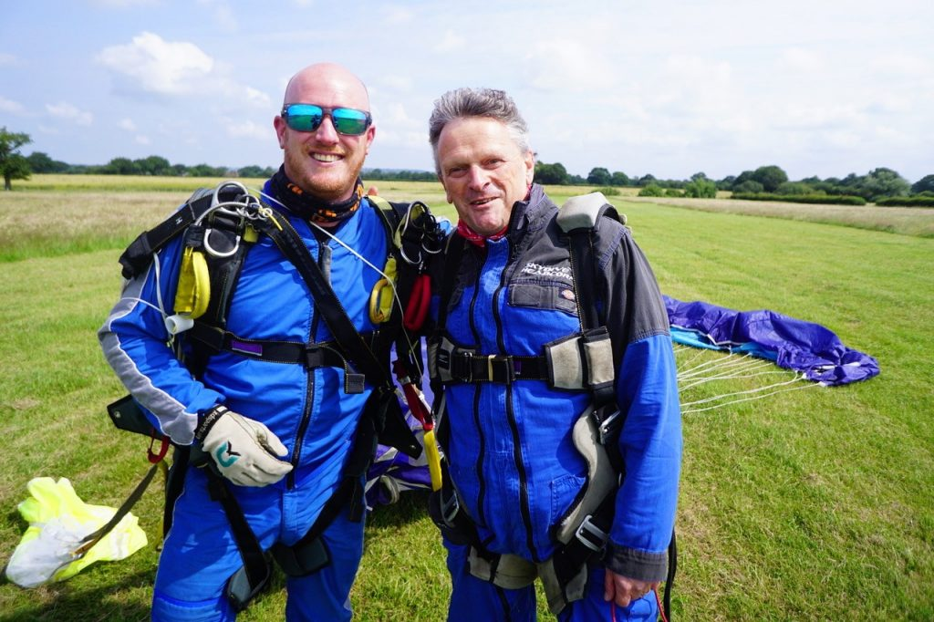 Chris and Steve pose for the camera, both smiling safely on Terra Firma