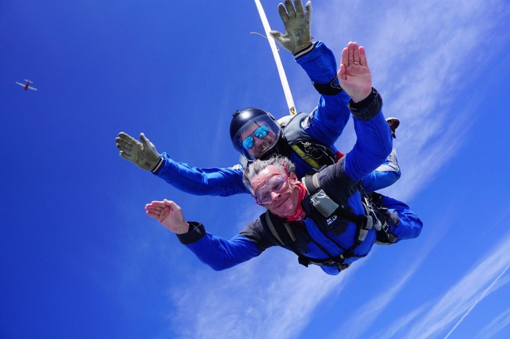 Chris high in the sky doing a tandem parachute jump