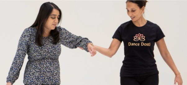 Photo of a Dance Dosti teacher guiding a participantEaling Volunteers needed for Dance Dosti